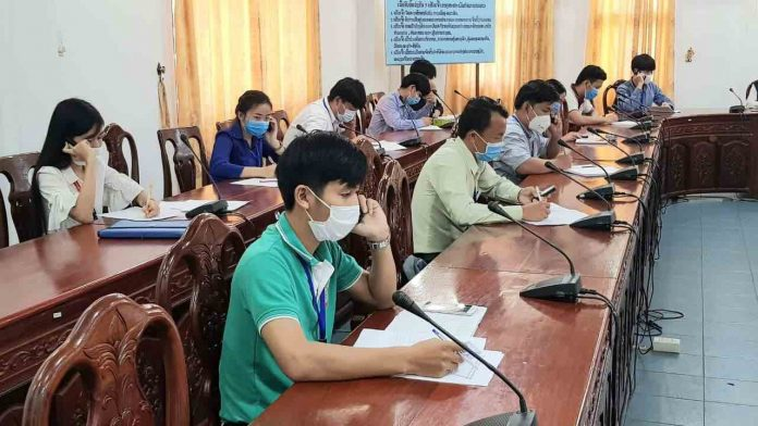 Hotline Call Center staff practice social distancing guidelines as they receive calls from the public 24 hour a day (Photo: CIEH MOH LAO)