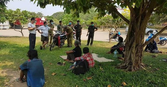 Police Assist Group of Homeless Laborers