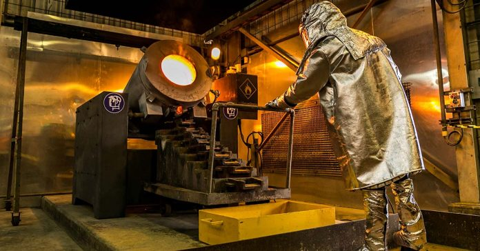 Gold pouring process at LXML's Sepon mine operation.