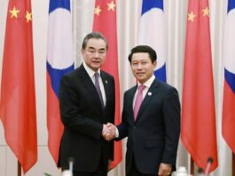 China's Foreign Minister Wang meets with Minister of Foreign Affairs Saleumxay Kommasith