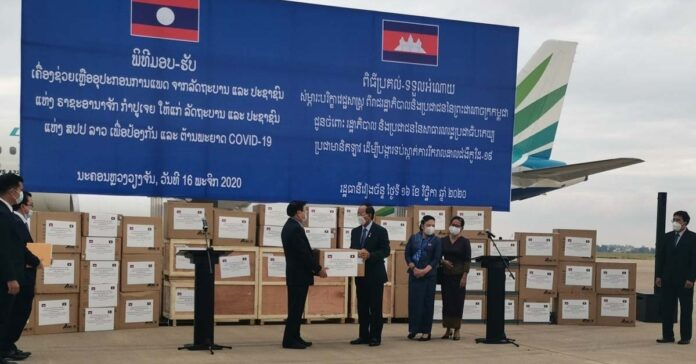 Cambodia hands over face masks to Laos