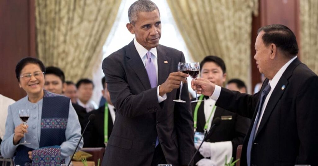 President Barack Obama and President Bounnhang Vorachith of Laos toast in the Dok Boua Ban Room at the Presidential Palace in Vientiane, Laos, Sept. 6, 2016. Standing at left is Pany Yathotou, President of the National Assembly of the Lao People's Democratic Republic. (Official White House Photo by Pete Souza)