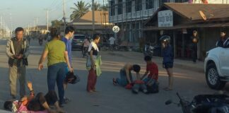 Mr. Khamla Phonsinan gives CPR at the scene of an accident in Vientiane