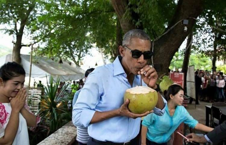 Obama drinks coconut water in Laos