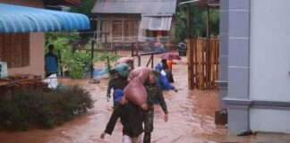 Military personnel assist villagers in flooded Luang Namtha