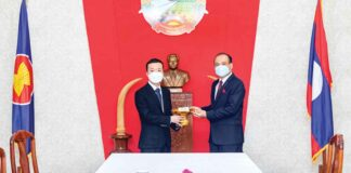 Chairman of Prince Holding Group hands over a donation to the Lao Embassy in Cambodia.